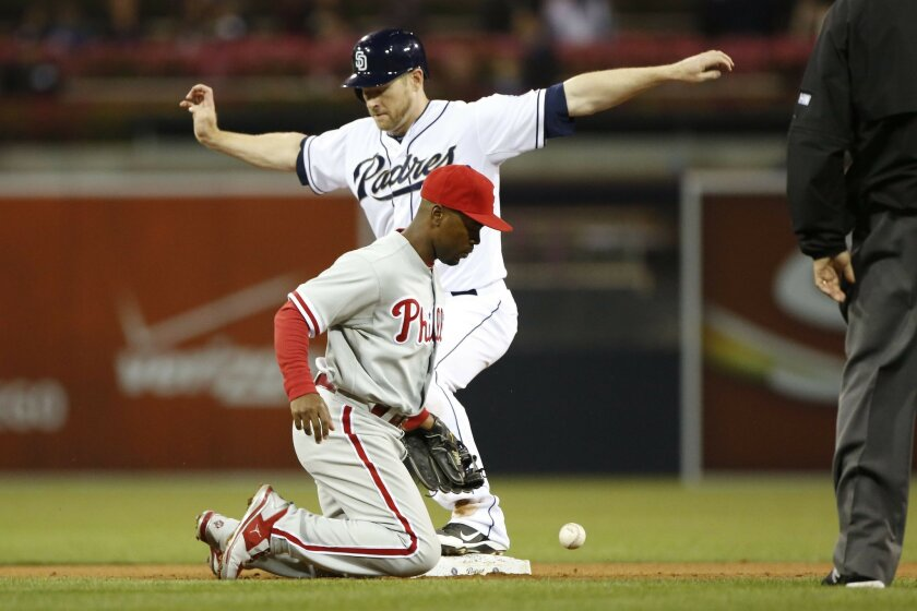 Chase Headley safe stealing second surind Jeremy Hermida at-bat Phillie short stop #11 Jimmy Rollins eyes the ball in the Padre eighth. .