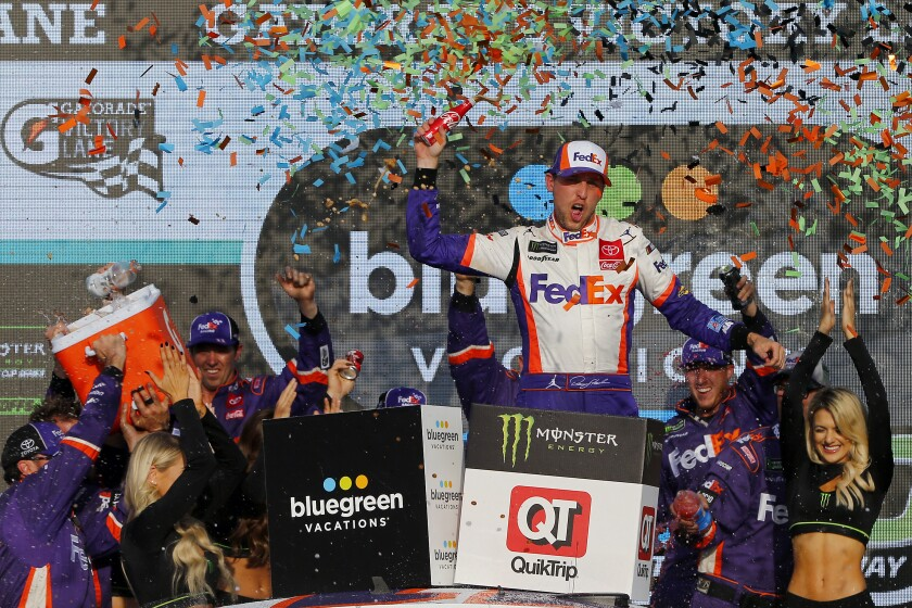 Denny Hamlin celebrates after winning Sunday's NASCAR Cup race at ISM Raceway.
