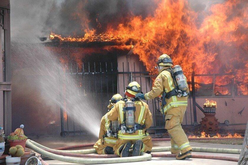 Firefighters battle the two-alarm blaze.