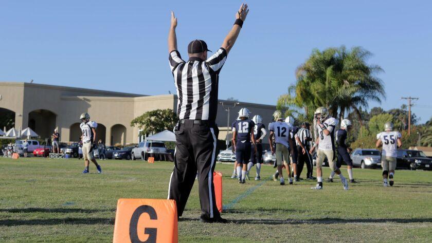 A referee signals a touchdown at Horizon Prep.