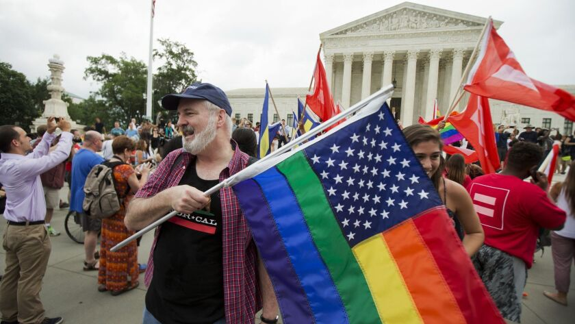 Gay-rights supports rally outside the U.S. Supreme Court building in Washington in 2015. The justices will likely have the final word on a case that extended job discrimination protections to gay people.
