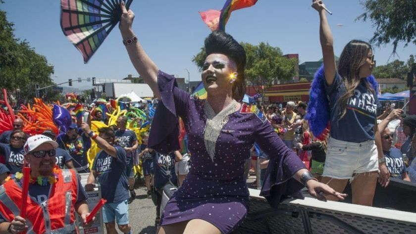 Revelers enjoy the 49th L.A. Pride parade in West Hollywood.