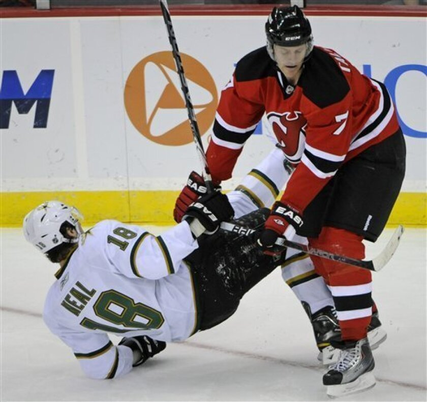 New Jersey Devils' Henrik Tallinder, right, checks Dallas Stars' James Neal to the ice during the second period of an NHL hockey game Friday, Oct. 8, 2010, in Newark, N.J. (AP Photo/Bill Kostroun)