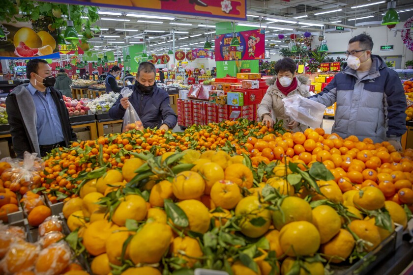 Shoppers at a supermarket in Beijing on Jan. 28.