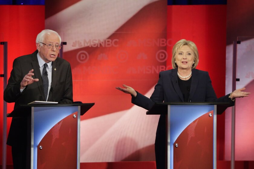Democratic presidential candidate, Sen. Bernie Sanders, I-Vt,  and Democratic presidential candidate, former Secretary of State Hillary Clinton spar during a Democratic presidential primary debate hosted by MSNBC at the University of New Hampshire Thursday, Feb. 4, 2016, in Durham, N.H. (AP Photo/D