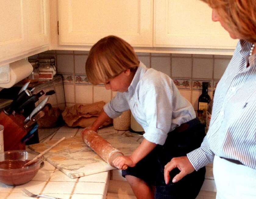 Young children might get just as much or more out of helping cook a meal as they would out of homework.