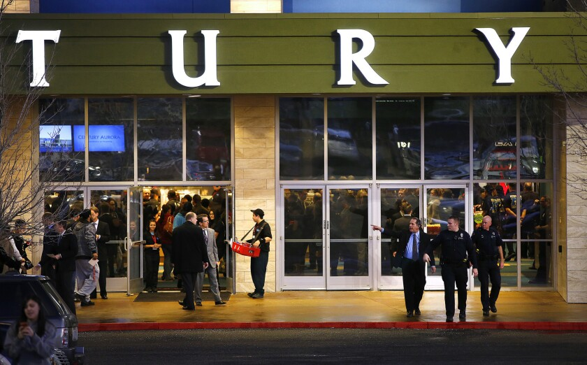 Invited guests make their way into a reopening ceremony and evening of remembrance at the Cinemark Century 16 Theaters in Aurora, Colo.