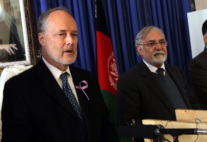 U.S. Ambassador to Afghanistan James Blair Cunningham, left, and the governor of Herat province, Sayed Fazlullah Wahidi, at a joint news conference in Herat, Afghanistan, on Wednesday.