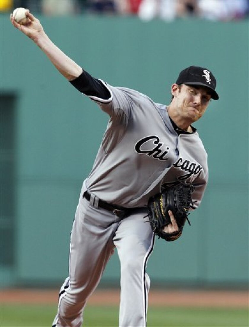 Chicago White Sox starting pitcher Philip Humber delivers to the Boston Red Sox in the first inning of a baseball game at Fenway Park, Tuesday, May 31, 2011, in Boston. (AP Photo/Elise Amendola)