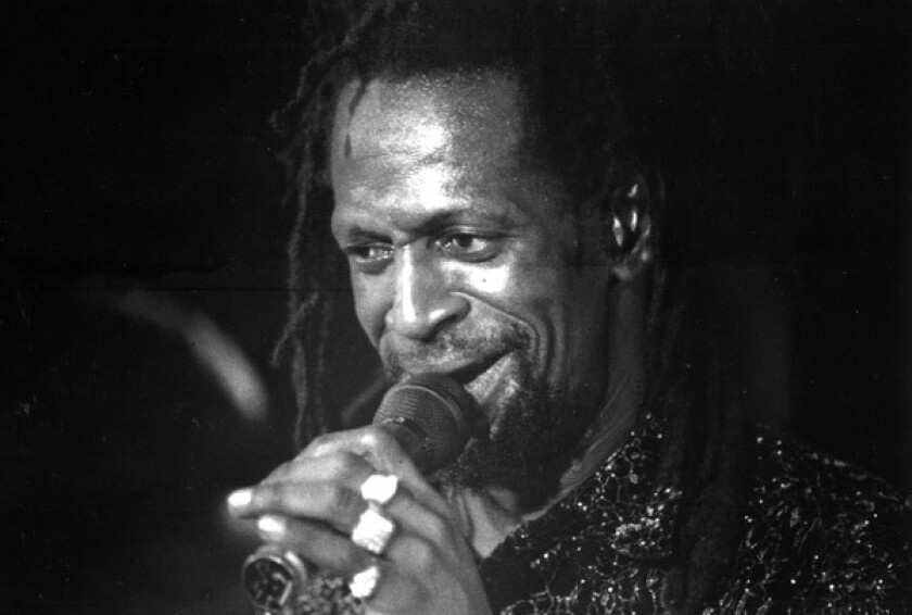 Gregory Isaacs in 1992 during a performance at the Veterans Auditorium in Culver City.