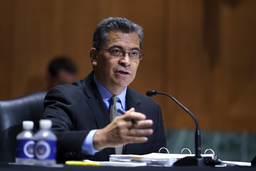 """FILE - In this June 10, 2021, file photo, Health and Human Services Secretary Xavier Becerra testifies before the Senate Finance Committee on Capitol Hill in Washington. The Biden administration Thursday, July 1, began putting in place consumer protections against """"surprise"""" medical bills enacted in bipartisan legislation signed last year by former President Donald Trump. (AP Photo/J. Scott Applewhite, File)"""