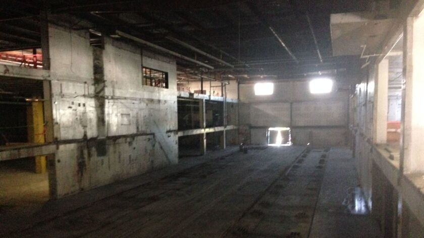 The interior of the print building where the newspaper presses were located will be transformed into an open-air courtyard.