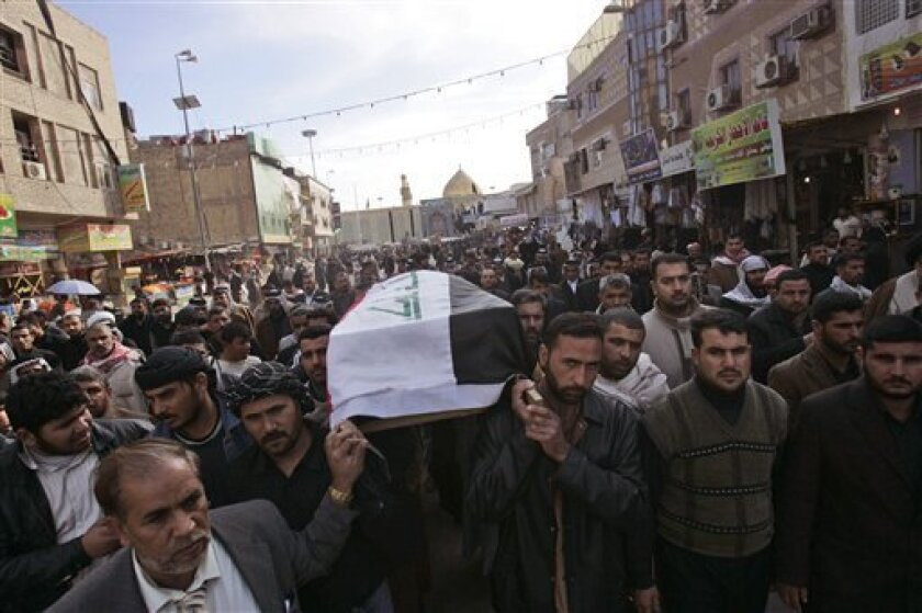 Mourners carry a coffin containing slain provincial council candidate Hashim al-Husseini in the Shiite city of Najaf, 160 kilometers (100 miles) south of Baghdad, Iraq, Saturday, Jan. 17, 2009.  The candidate was assassinated Friday while campaigning south of Baghdad, officials said. The killing of