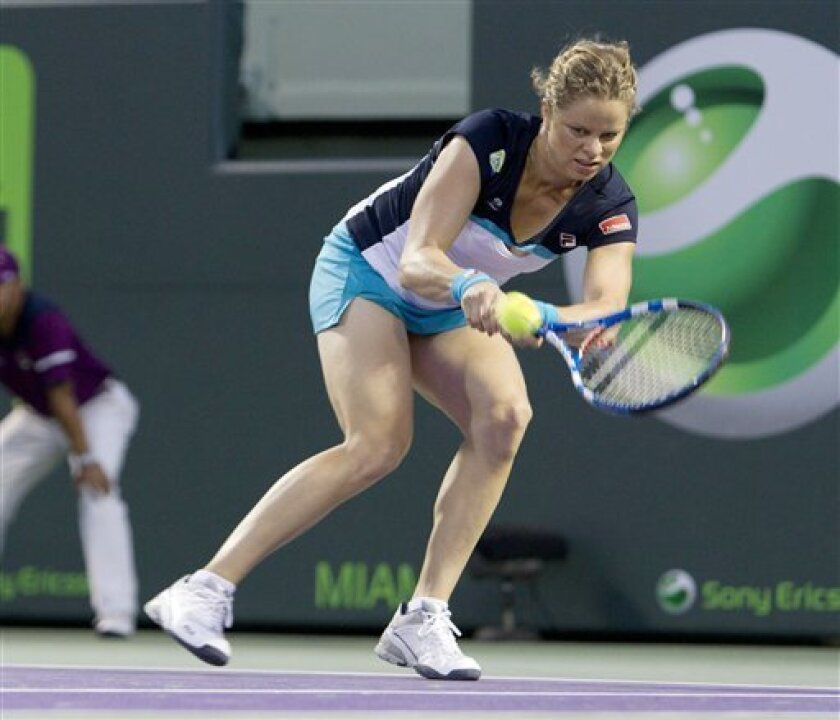 Kim Clijsters, from Belgium, returns the ball to Victoria Azarenka, of Belarus, at the Sony Ericsson Open tennis tournament in Key Biscayne, Fla., Tuesday, March 29, 2011. (AP Photo/J Pat Carter)