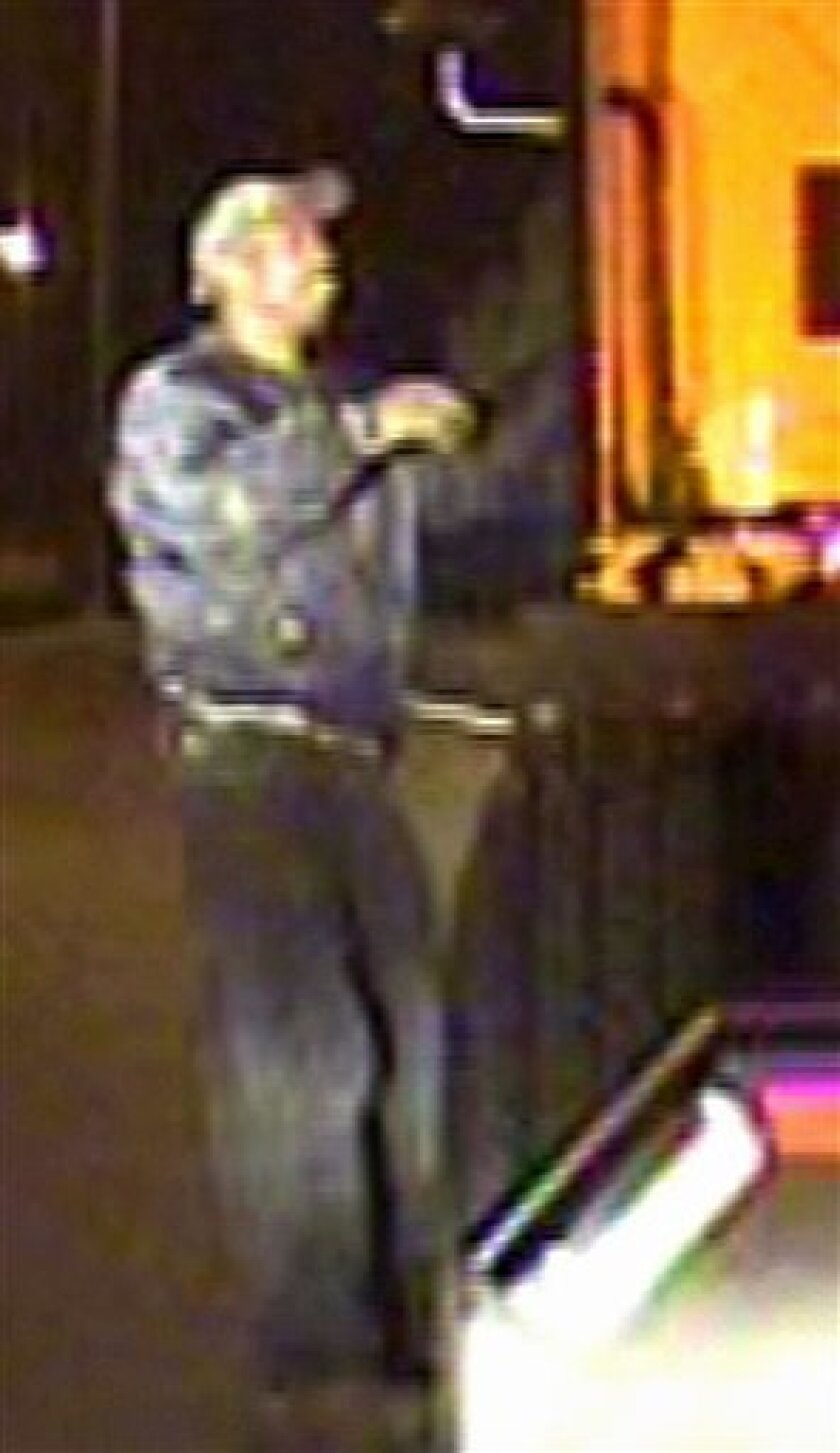 This image made from surveillance video released by the Riverside Police Department Monday, Nov. 8, 2010, shows a man authorities say they believe is the gunman suspected of fatally shooting Riverside police officer Ryan Bonaminio earlier in the day. (AP Photo/Riverside Police Department)