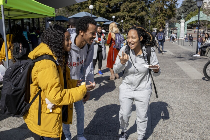 """UC Berkeley students chat during """"Black Wednesday"""" on Sproul Plaza."""