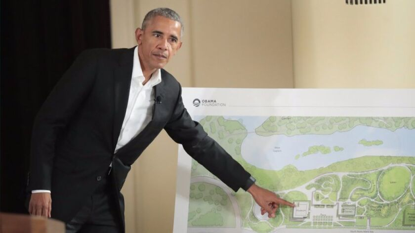 Former President Barack Obama points out features of the proposed Obama Presidential Center.