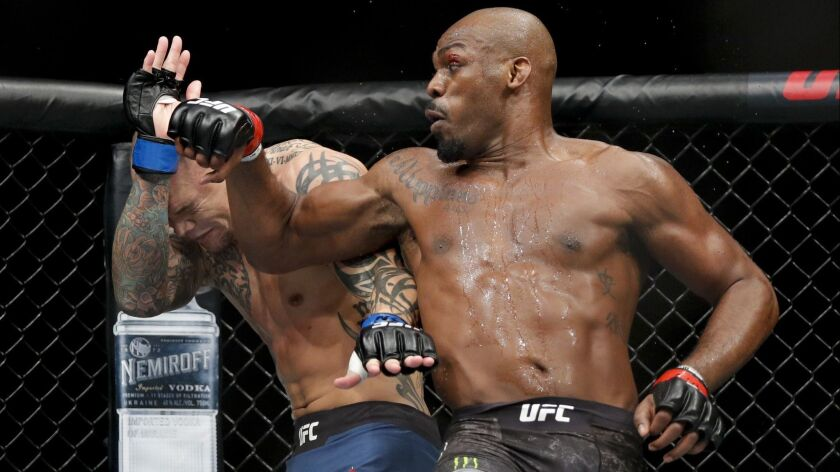 Jon Jones, right, fights Anthony Smith in a light heavyweight mixed martial arts title bout at UFC 2