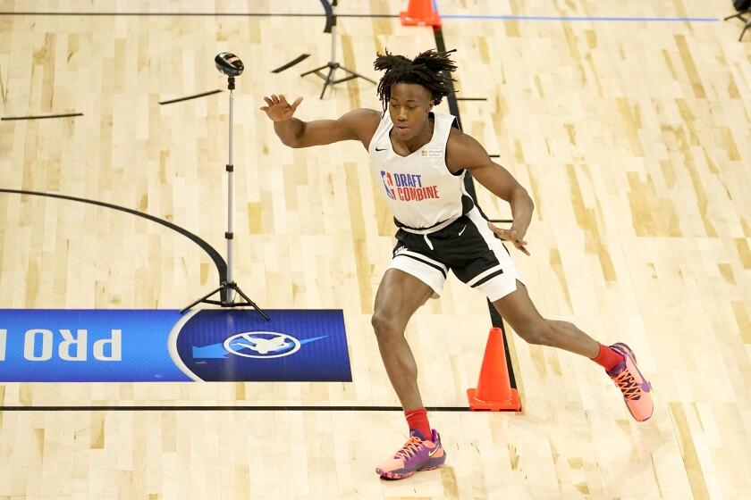 Illinois' Ayo Dosunmu runs the cone drill during the NBA draft combine.