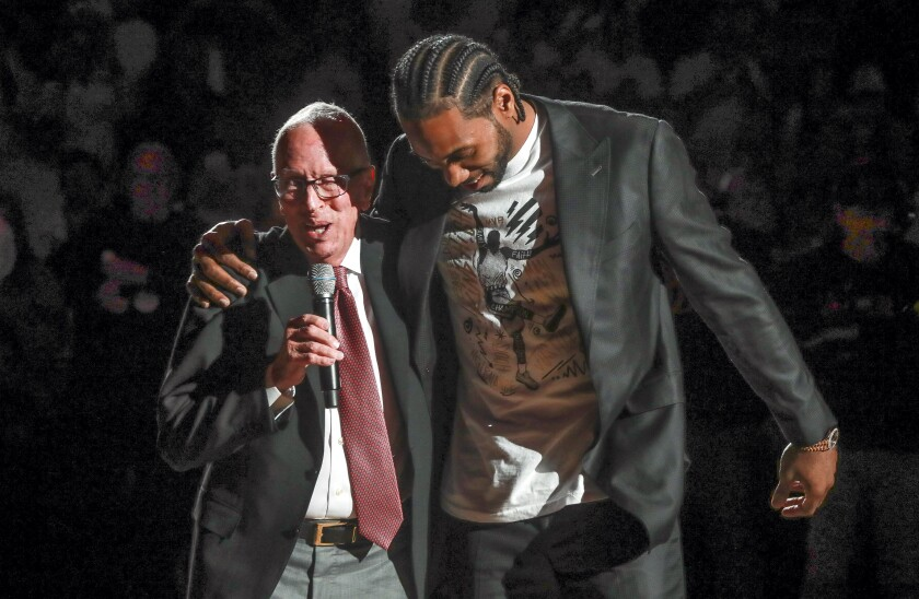 Two-time NBA Finals MVP Kawhi Leonard with former Aztecs coach Steve Fisher during a ceremony Saturday to retire his jersey at Viejas Arena.