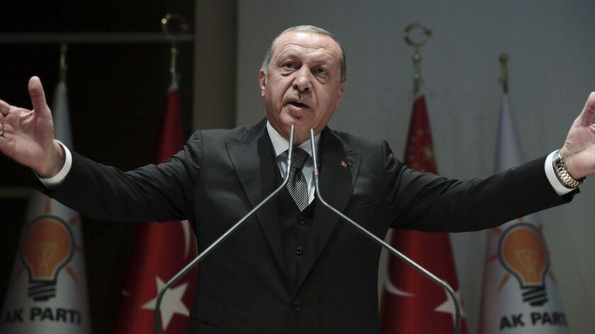 Turkish President Recep Tayyip Erdogan, delivers a speech to supporters in Ankara, Monday, Oct. 22,