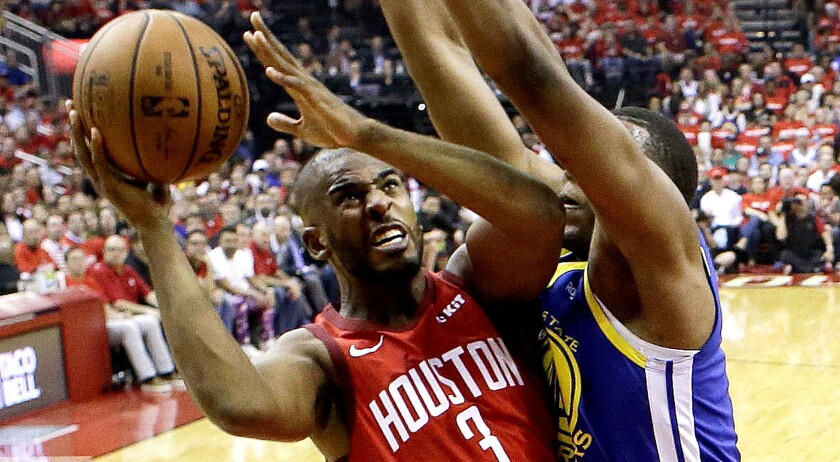 Houston Rockets guard Chris Paul (3) drives to the basket as Golden State Warriors center Kevon Loon