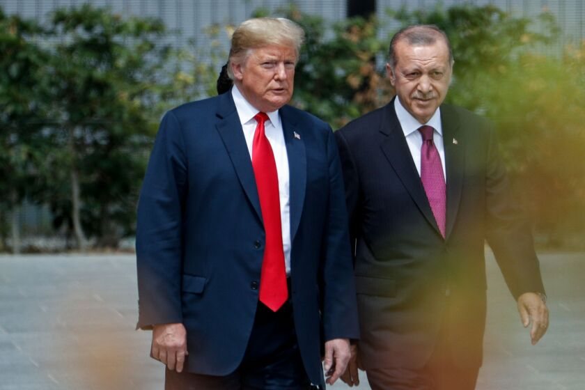 President Trump speaks to Turkey's President Recep Tayyip Erdogan during the opening ceremony of the NATO summit in Brussels on July 11, 2018.
