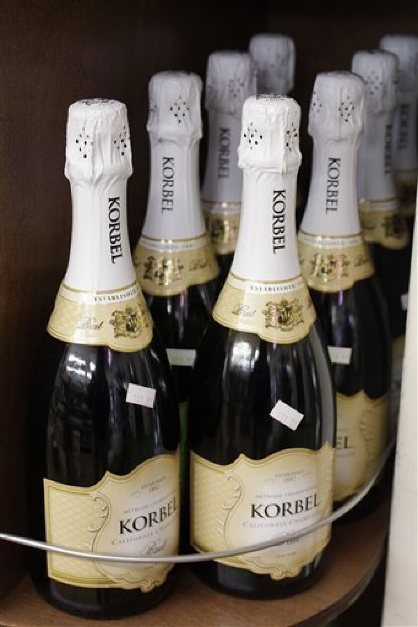 FILE - In this March 6, 2011 file photo, bottles of Korbel sparkling wines are displayed at a liquor store in Palo Alto, Calif. Liquor company Brown-Forman Corp. said Thursday, Junw 9, 2011, that its profit more than doubled in its fiscal fourth quarter as the company sold its California-based Fetzer Vineyards while its flagship Jack Daniel's brand posted strong international sales. (AP Photo/Paul Sakuma, file)