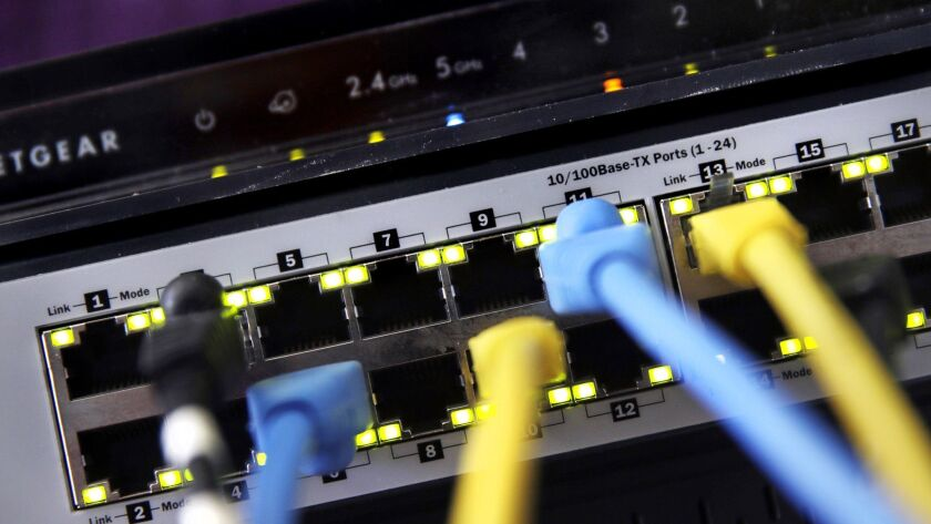 House Democrats introduced a bill Wednesday to restore the strict net neutrality rules the Federal Communications Commission adopted in 2015, governing how internet service providers handled traffic flowing over routers and switches like the one displayed in East Derry, N.H.