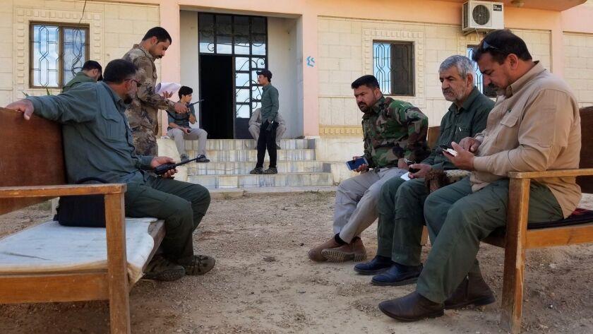 QAIM, IRAQ MAY 16, 2018 -- Hajj Qassem Musleh (far right), a commander in the Iraqi paramilitary fo