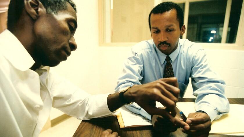 """(L-R)- Walter McMillian and Bryan Stevenson in a scene from """"True Justice: Bryan Stevenson's Fight F"""