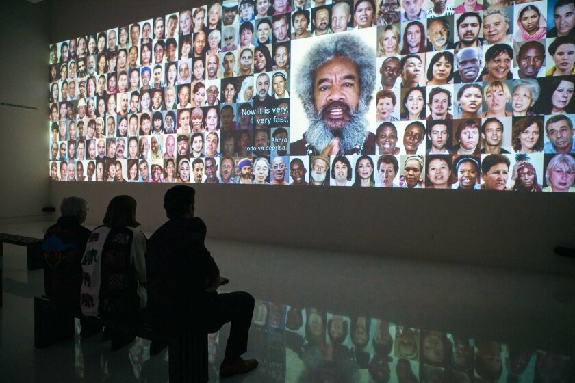 The video mosaic '7 Billion Others' at MOPA through Sept. 13.