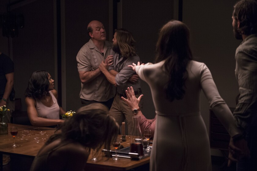 Pruitt (John Carroll Lynch) attempts to calm Will (Logan Marshall-Green) during a tense moment in Drafthouse Films' ?The Invitation.""