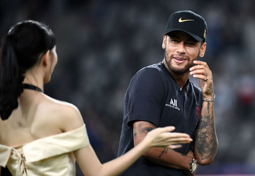 Paris Saint-Germain's Brazilian forward Neymar arrives on the podium at the end of the French Trophy of Champions football match between Paris Saint-Germain (PSG) and Rennes (SRFC) at the Shenzhen Universiade stadium in Shenzhen on August 3, 2019. (Photo by FRANCK FIFE / AFP)FRANCK FIFE/AFP/Getty Images ** OUTS - ELSENT, FPG, CM - OUTS * NM, PH, VA if sourced by CT, LA or MoD **