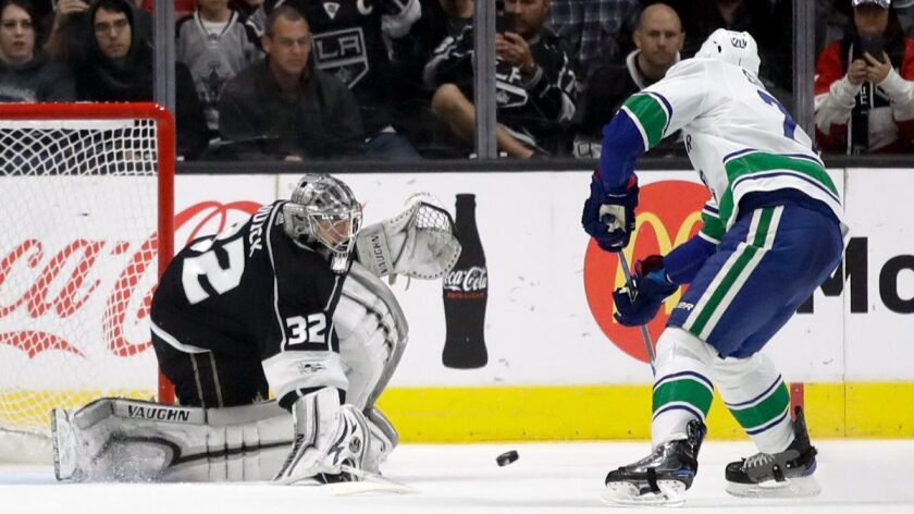 Los Angeles Kings goalie Jonathan Quick, left, blocks a a penalty shot by Vancouver Canucks center B