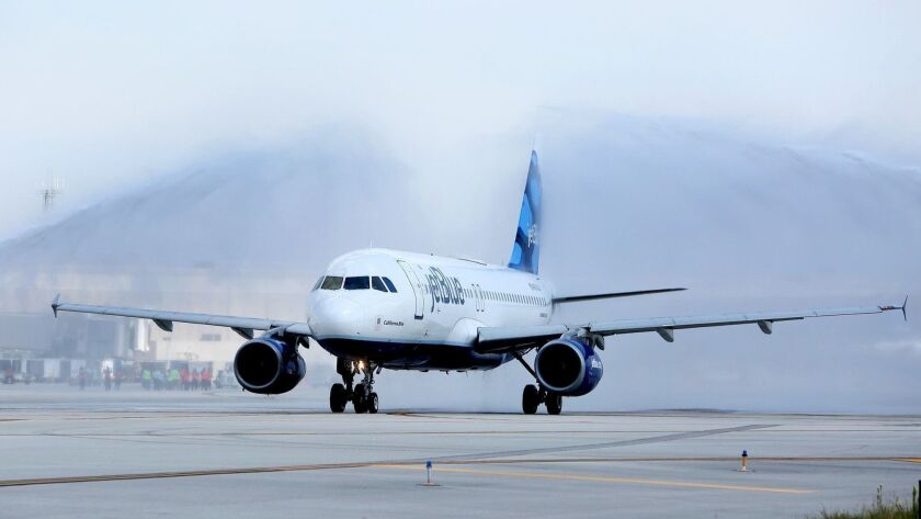 Jet Blue's inaugural flight from Fort Lauderdale to Mexico City taxis down the runway with a water s
