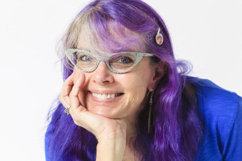 SAN DIEGO, CA-SEPTEMBER 9, 2012: Maryelizabeth Yturralde, co-owner of Mysterious Galaxy Books, poses for photos in the UT studio on Wednesday in San Diego . (Eduardo Contreras / San Diego Union-Tribune)