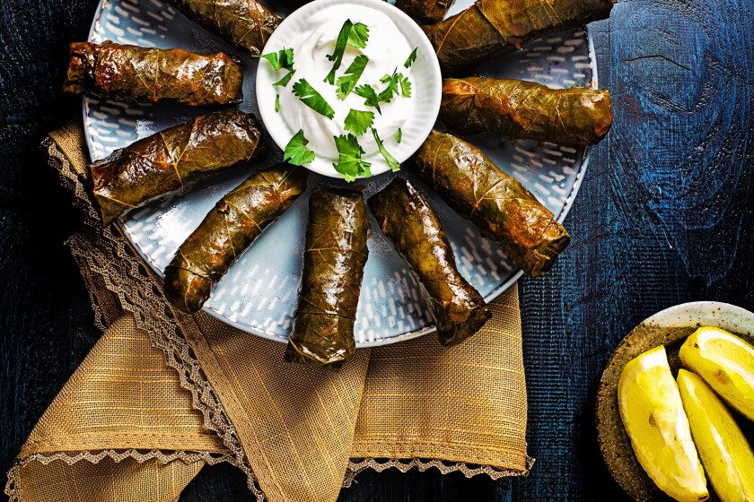 Fresh grape leaves are stuffed with spiced lamb and rice.