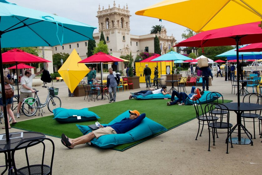 Anit Kuruvilla, who is visiting from northern California, lays back in a large cushion at Balboa Park Plaza de Panama on Wednesday in San Diego, California. The new amenities were made possible by an $85K grant from Southwest Airlines.