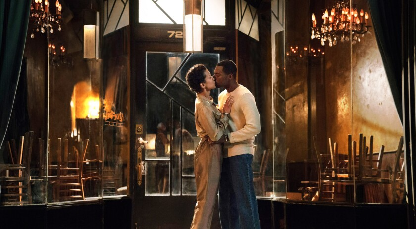 """Michele Weaver and Will Catlett play young lovers in the late 20th century in a scene from the OWN series """"Love Is_,"""" based on the romance of series creators Mara Brock Akil and Salim Akil."""