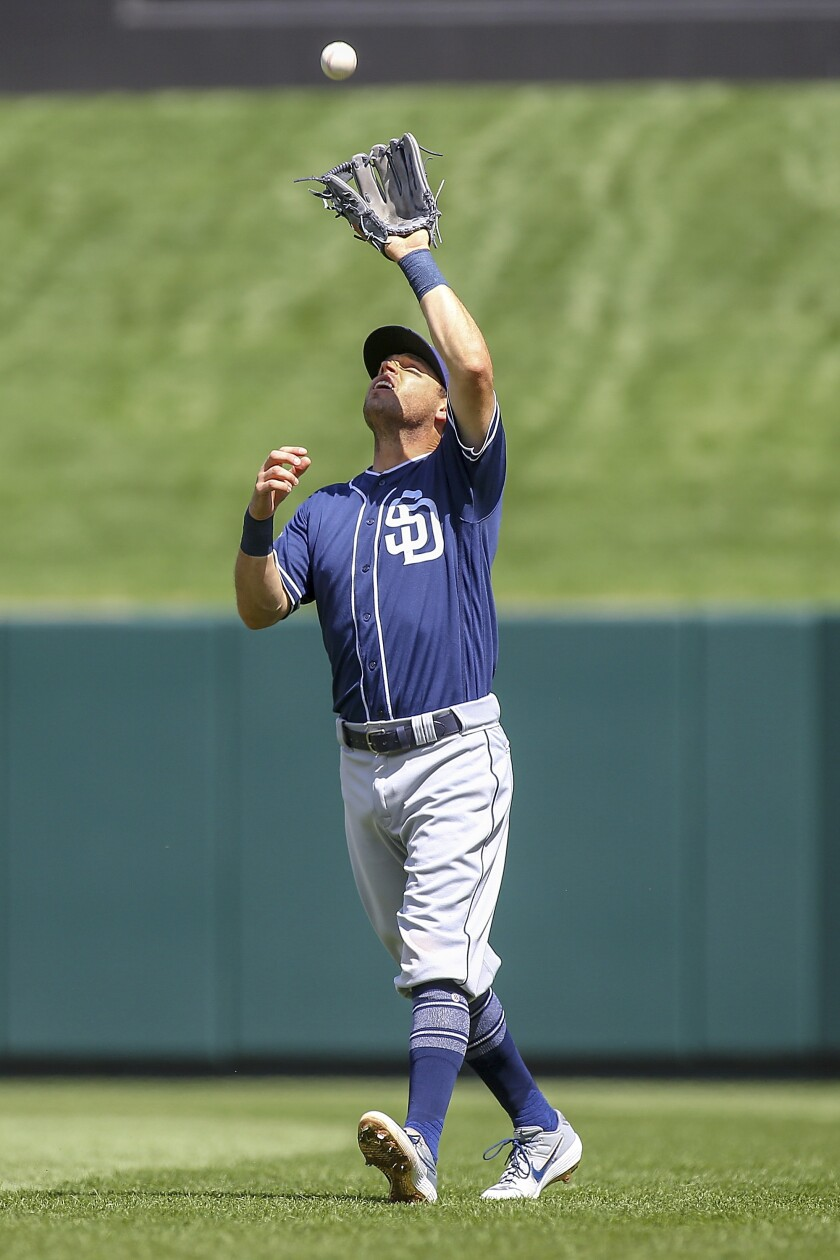 Padres second baseman Ian Kinsler catches a fly ball in the second inning of Sunday's game against the Cardinals.