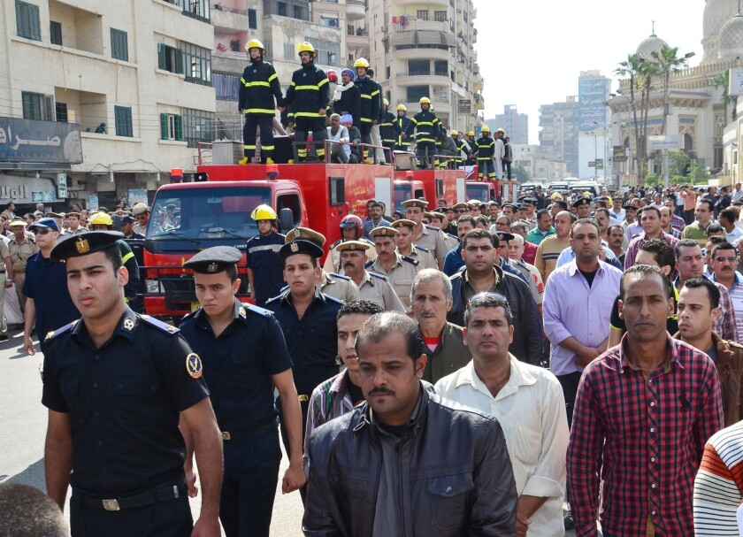 Egyptians escort firetrucks carrying coffins of three police officers who were killed during an attack against security forces on Monday in the Nile Delta city of Mansoura.
