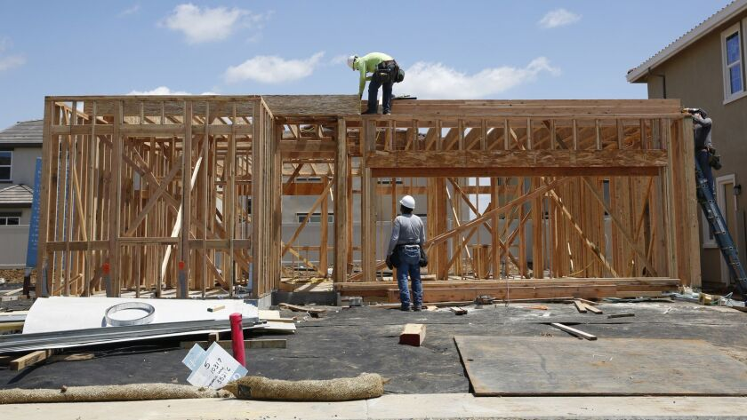 FILE -- In this May 23, 2019 file photo, construction is done on a home in a housing development in