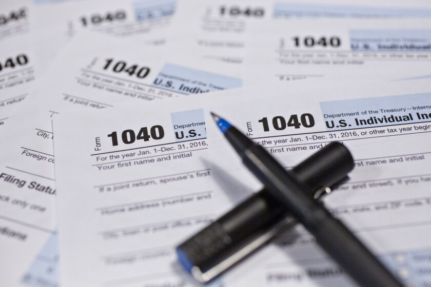 Internal Revenue Service 1040 Individual Income Tax forms for the 2016 tax year on Dec. 18, 2017.