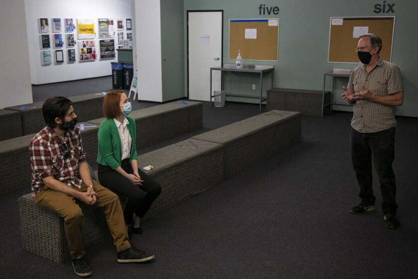 Actors Matt Grossman and Jocelyn Hall receive instructions from camera operator Dave Reifsnyder