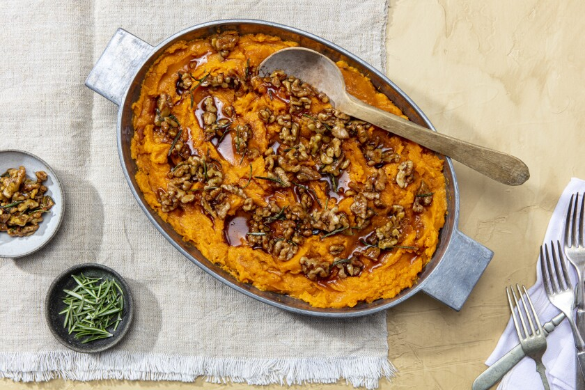 LOS ANGELES, CALIFORNIA, Nov. 4, 2020: Very Slow-Roasted Yams with Rosemary-Maple Walnuts for LA Times Cooking section's Thanksgiving 2020 story and recipes by Ben Mims, photographed on Wednesday, Nov 4, 2020, at Proplink Studios in Arts District Los Angeles. (Photo / Silvia Razgova, Food styling / Ben Mims, Prop styling/ Kate Parisian) ATTN: 644074-la-fo-new-thanksgiving-2020