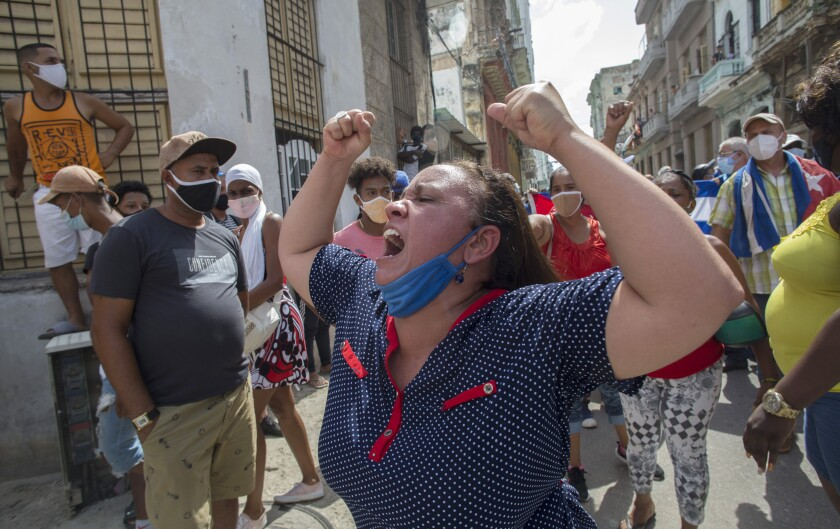 A woman shouts pro-government slogans as anti-government protesters march in Havana, Cuba, Sunday, July 11, 2021.