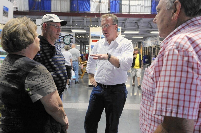 Ron Nehring, the Republican candidate for lieutenant governor, chats with visitors at the California State Fair in Sacramento in July. Nehring is running a long-shot campaign against incumbent Gavin Newsom, a Democrat.