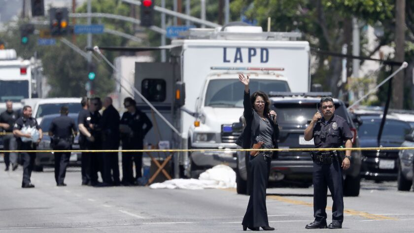 LOS ANGELES, CALIF. - AUG. 6, 2018. Police set up a command post near the intersection of Central A