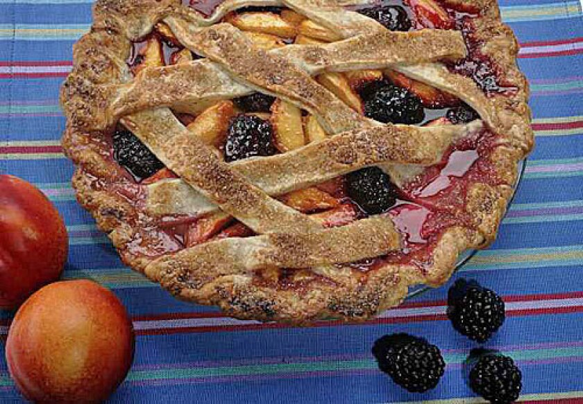 JUST A PINCH: Juicy nectarines and plump blackberries cavort merrily in a lattice-top pie. Black pepper adds an intriguing dark note to the crust.
